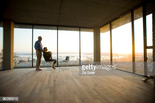 mature couple in new condo, sunset : Bildbanksbilder