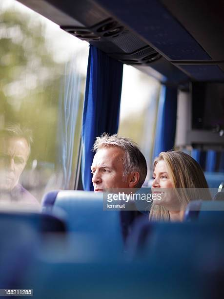 Mature couple inside a bus