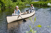 Mature couple kayaking