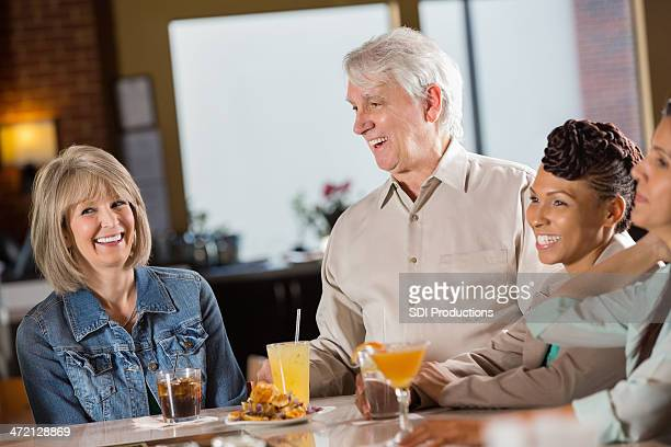 mature couple laughing together at a restaurant