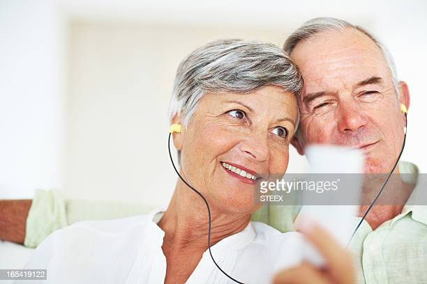 Mature couple listening to music together