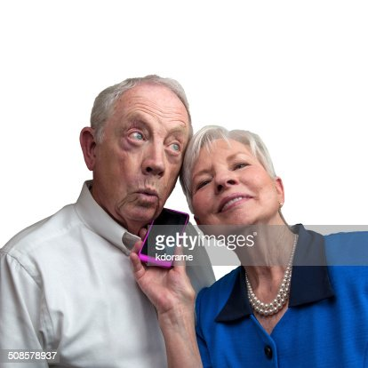 Mature Couple Listening Together on Cell Phone : Stock Photo