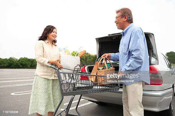 Mature Couple Loading Boot of Car with Shopping