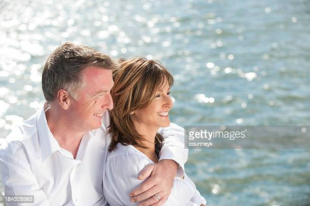 Mature couple looking away