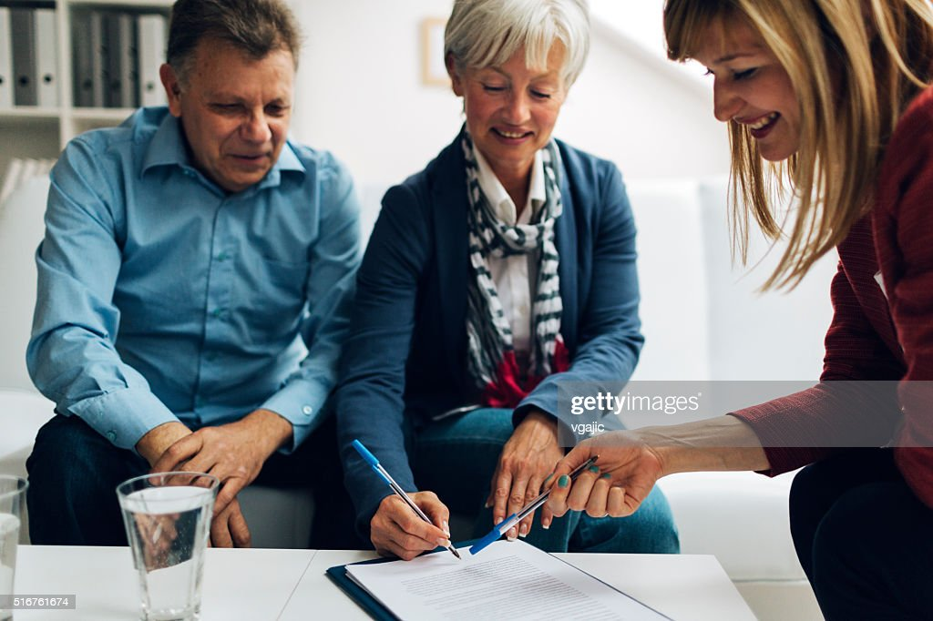 Mature Couple Meeting with Financial Advisor. : Stock Photo