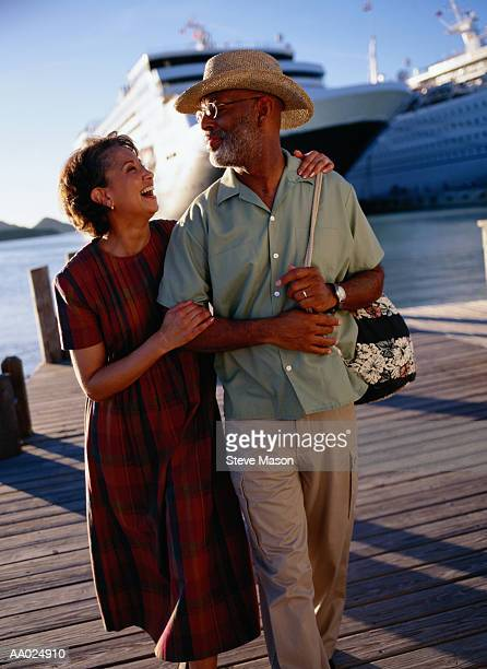 Mature Couple on a Pier Near a Cruise Ship