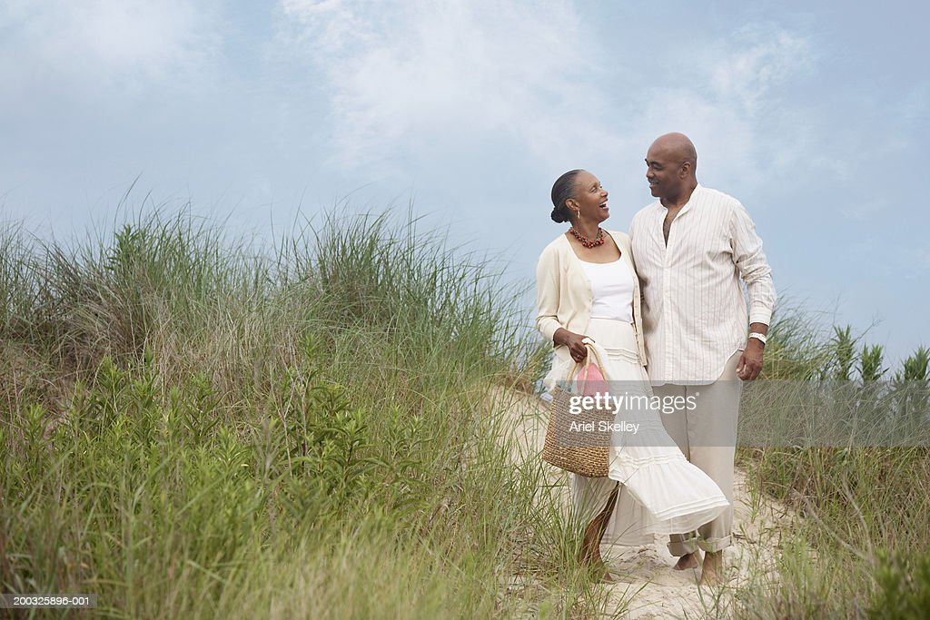 Mature couple on beach path : Stock Photo