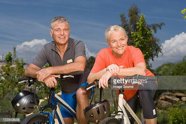 Mature couple on bicycles