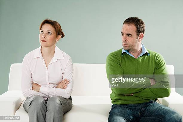 Mature couple on couch having an argument