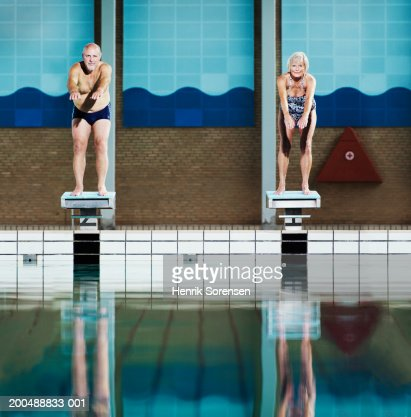 Mature Couple On Diving Boards In Swimming Pool Portrait Stock Photo Getty Images