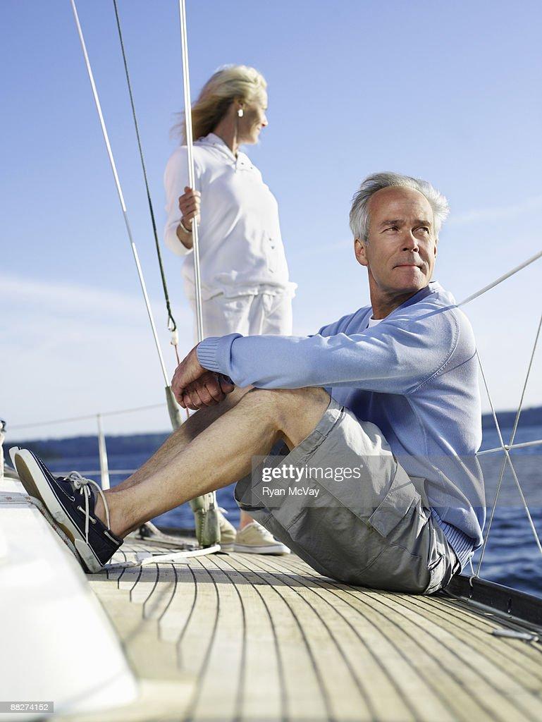 Mature couple on sailboat : Stock Photo