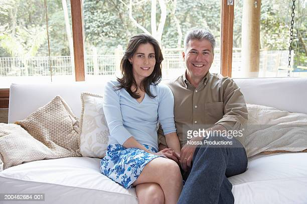 Mature couple on sofa, portrait