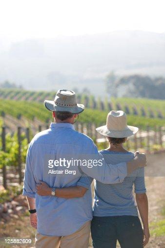 Mature couple on wine farm : Stock Photo