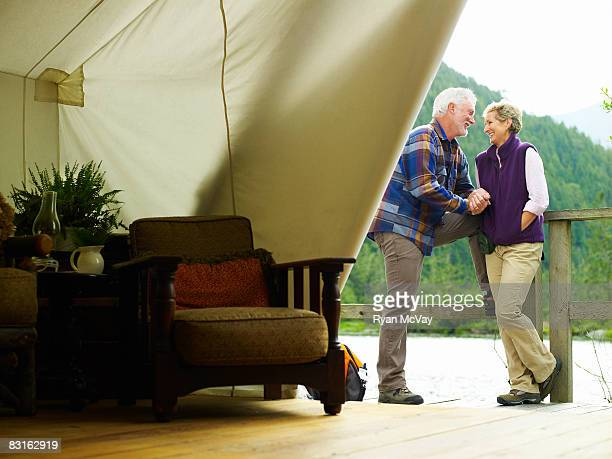 Mature couple outside of luxury tent.