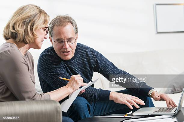Mature couple paying bills