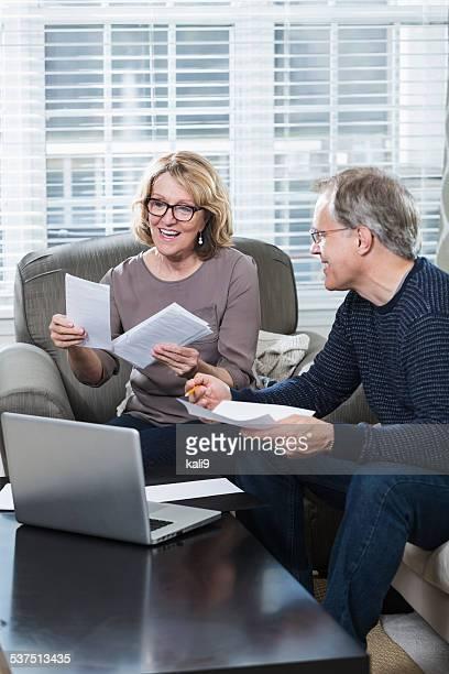 Mature couple paying bills