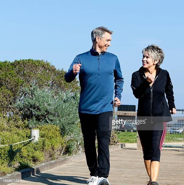 mature couple power walking