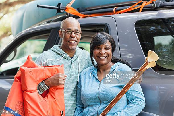 Mature couple preparing to go canoeing