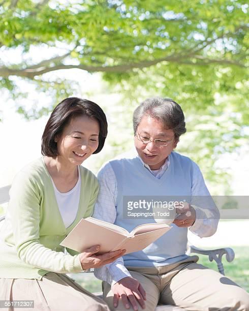 Mature Couple Reading Book