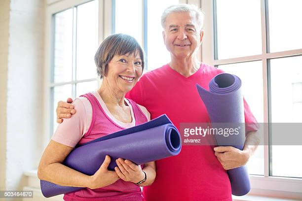Mature couple ready for yoga workout
