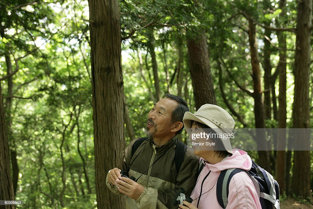 Mature couple relaxing in a park : Stock Photo