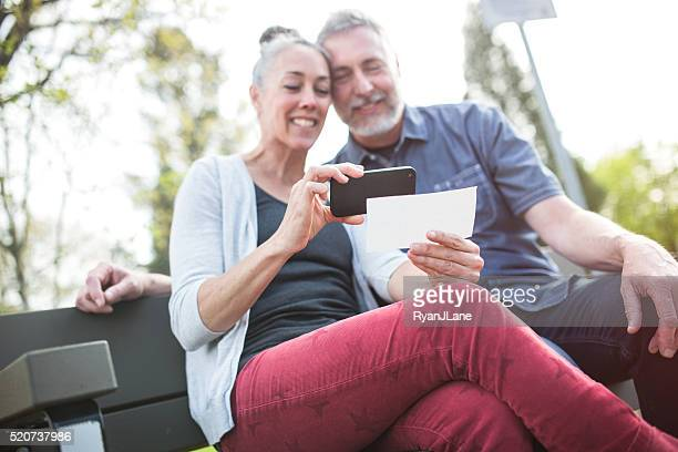 Mature Couple Remote Banking with Phone
