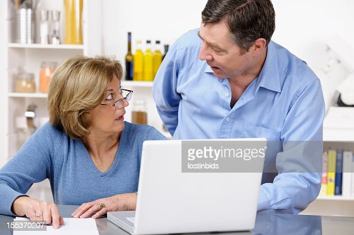 Mature Couple Reviewing Statement In Horror