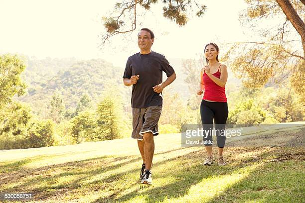 Mature couple running in park