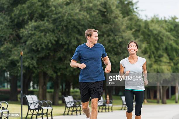 Mature couple running together in a park