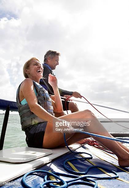 Mature couple sailing boat