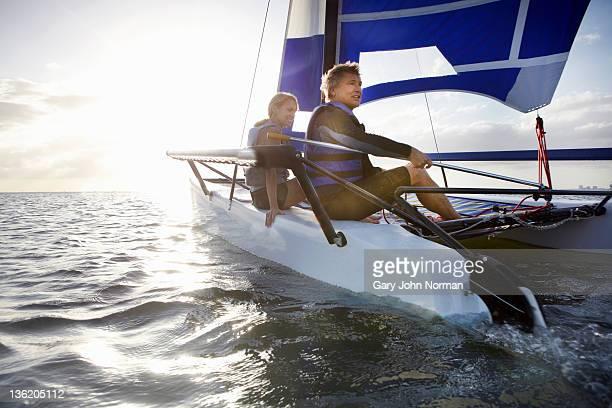Mature couple sailing small boat