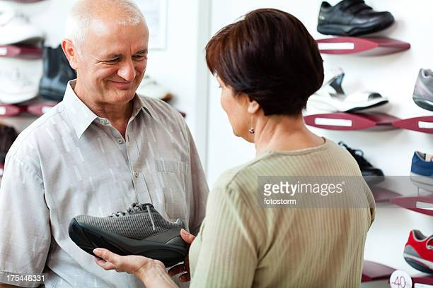 Mature couple shopping for sport shoe
