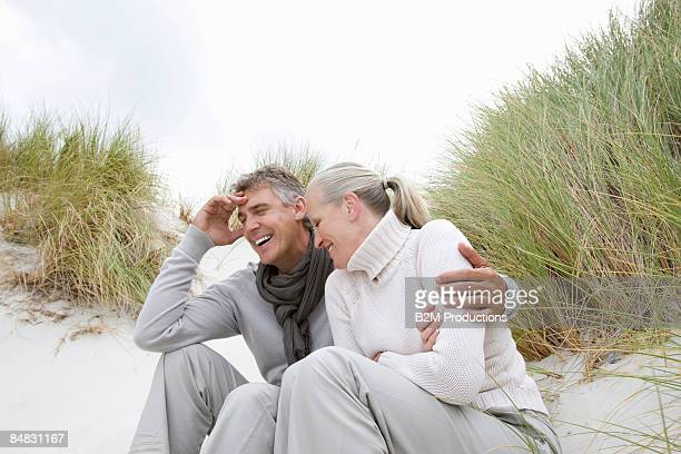 Mature couple Sit in Dune Grass
