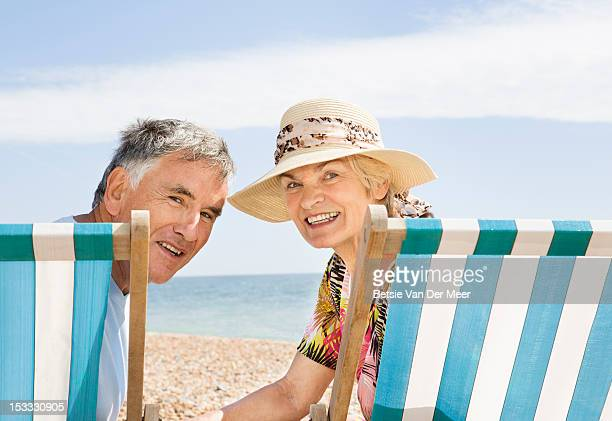 mature couple sitting in deckchairs.