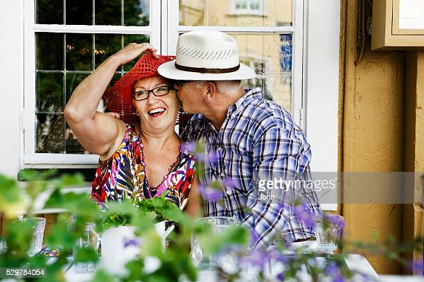 Mature couple sitting in front of window