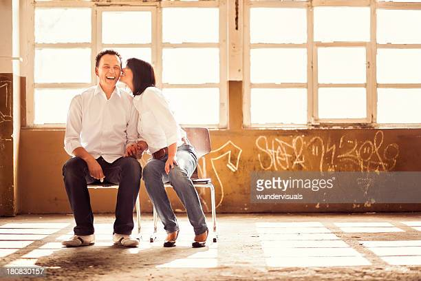 Mature couple sitting in old industry building