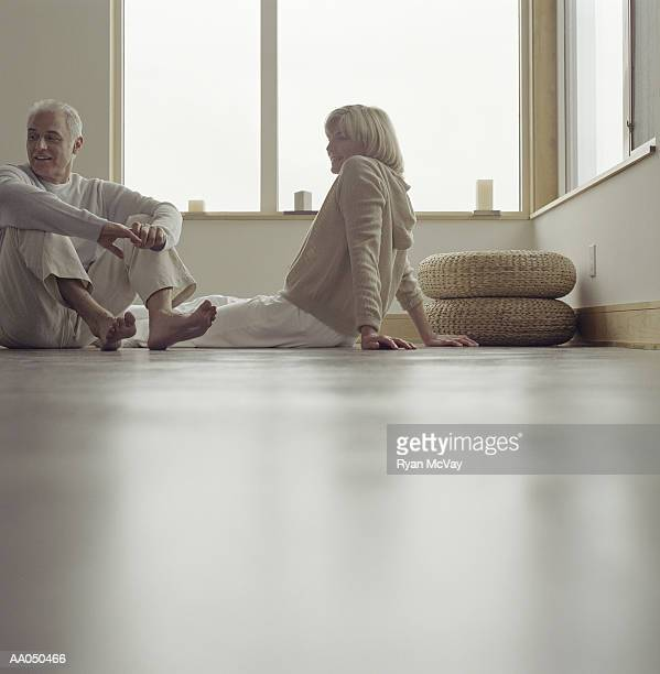 Mature couple sitting on floor