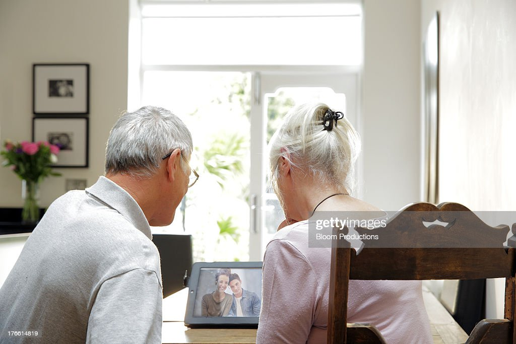 Mature couple skyping their family : Stock Photo