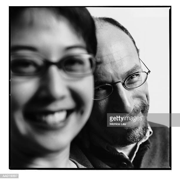 Mature couple smiling, close-up, portrait (focus on man, B&W)