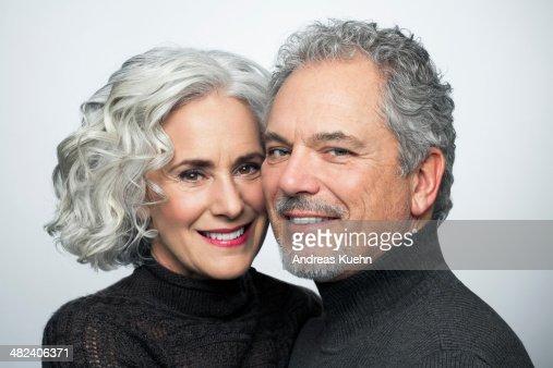 Mature couple smiling for camera, portrait.
