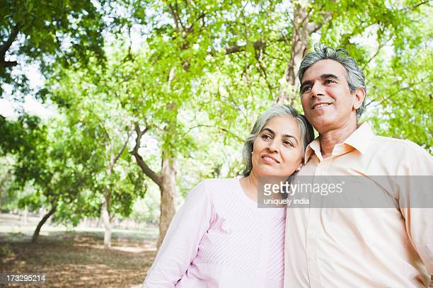 Mature couple standing in a park and smiling, Lodi Gardens, New Delhi, India