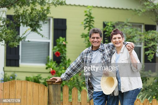Mature couple standing in yard