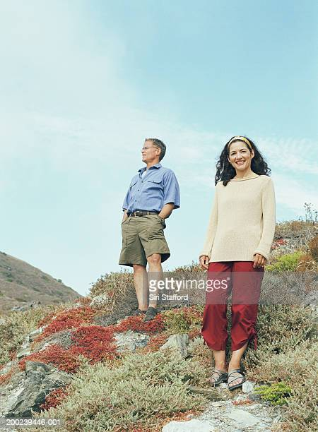 Mature couple standing on bluff