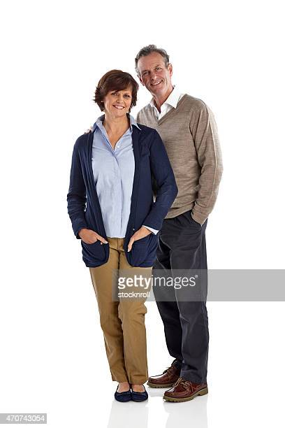 Mature couple standing together in studio