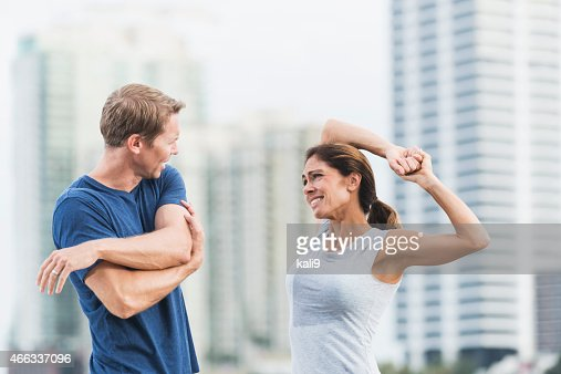 Mature couple staying fit in the city