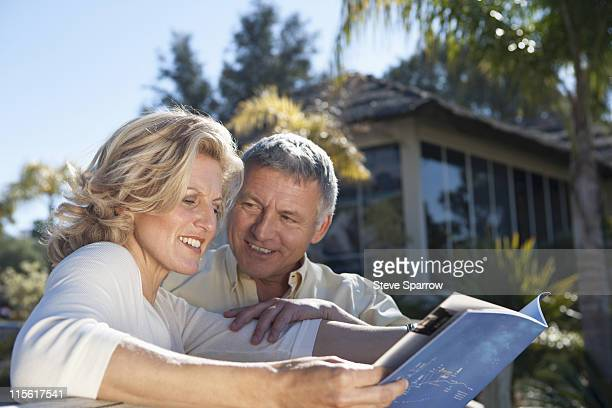 Mature couple studying realestate book