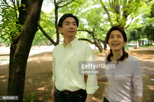 Mature couple taking a stroll in the park : Stock Photo