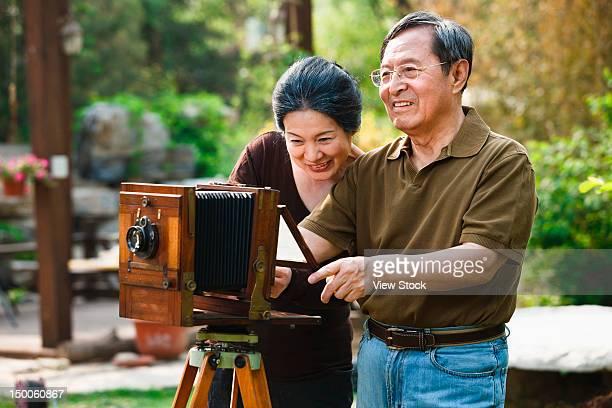 Mature couple taking photos