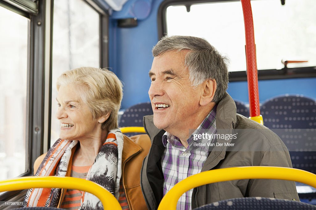 Mature couple traveling by bus. : Stock Photo