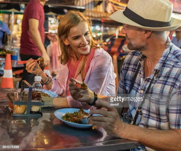 Mature Couple Trying Thai Street Food in Bangkok